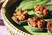 Vegetable fritters in banana leaves