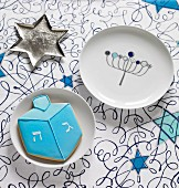 A start-shaped sliver dish, a plate and a a biscuit for Hanukkah