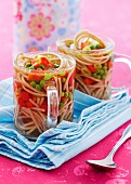 Noodle soup with vegetables in two glasses