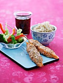 Sesame salmon skewers with rice and vegetables
