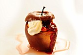 A baked apple filled with wild cherries