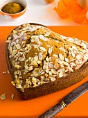 A heart-shaped marzipan cake with flaked almonds