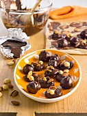 Marzipan pralines with chocolate glaze and nuts