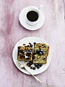 Mini blueberry and almond cake and a cup of coffee (seen from above)