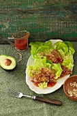 Sweet and spicy soja medallions on a bed of lettuce