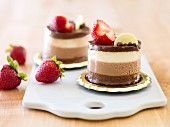 White and dark chocolate mousse dessert with fresh strawberries