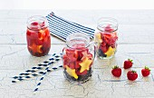 Three preserving jars with strawberries, blueberries and pineapple stars in the colours of the American flag