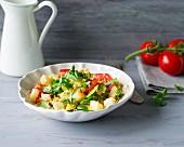 A warm quinoa salad with vegetables