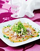 Smoked salmon with fresh thyme, steamed leek, red onions and almonds