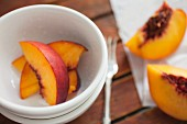 A bowl of peach slices