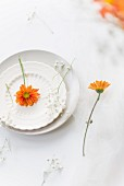 A summer place setting with baby's breath and marigolds