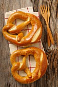 Two pretzels on a tea towel