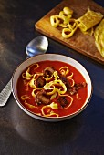 Tomato soup with porcini mushrooms and pancake strips