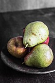 Four pears on a plate
