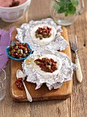 Camembert grilled in foil with dried tomatoes, capers and green peppers