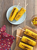 Grilled corncobs with garlic and chilli olive oil