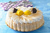 A lemon Charlotte topped with meringue and lemon macaroons