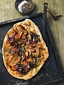 Pizza bianca with red onions and porcini mushrooms