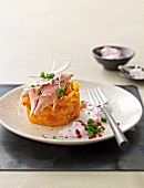 Mashed pumpkins and potatoes with smoked fish