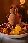 Candied fruits on a plate decorated with a teddy bear