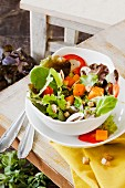 A mixed leaf salad with pumpkin and pepper