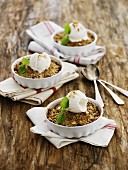 Apple, marzipan and honey-roasted muesli crumble with almonds, vanilla ice cream and lemon balm