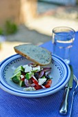 Greek salad on table out of doors