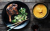 Duck legs with a soy glaze, boy choy and a dip