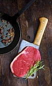 A rump steak on a meat cleaver