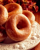 Glazed doughnuts on a white plate