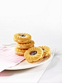 Sandwich biscuits with cream and strawberry jam