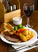 Roast beef with sides and red wine