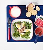 Rocket salad with egg, milk and crisps