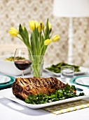 Roast lamb and a glass of red wine on an Easter table