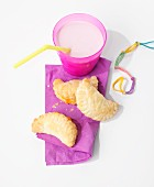 Empanadas with a cheese filling and milk as a snack for children