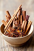 Cinnamon sticks and star anise in a wooden bowl