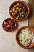 Mixed marinated olives with dried tomatoes and freshly grated Parmesan