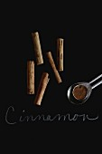 Cinnamon sticks and ground cinnamon with a label