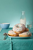 Doughnuts with icing sugar and colourful sugar sprinkles
