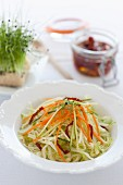 Raw vegetable salad with dried tomatoes and bean sprouts