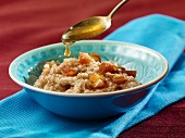 Sweet cracked wheat porridge with honey and dates
