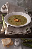 Cream of asparagus soup with croutons