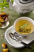 Herbal tea with verbena and madeleines