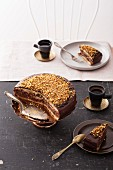 Chocolate cake, sliced, served with espresso