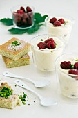 Lemon and pistachio cake and lemon cream with raspberries