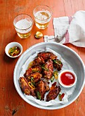 Chicken wings with chilli sauce and beer