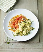 Herb scrambled eggs with fried tomatoes and mushrooms for an alkaline diet