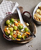 Stir-fried oriental Brussels sprouts with dried apricots and sheep's cheese