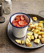 Oven-roasted tomatoes with caraway potatoes for an alkaline diet