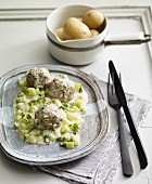 Meat balls with braised cucumbers and new potatoes